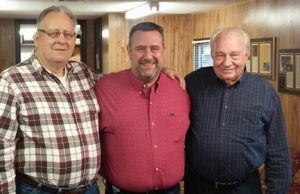 "NeSmith Racing Founder and CEO Mike Vaughn reminisces with lifelong friends 2015 National Dirt Late Model Hall of Fame Inductee Leon ""Slick"" Sells on the left and Brad Hendricks on the right.  The National Dirt Late Model Hall of Fame has announced that Vaughn will introduce his boyhood hero Sells at the 2015 Induction Ceremony on August 8 at the Hall located on the grounds of Florence Speedway in Walton, KY.  (Adam Stewart Photo)"