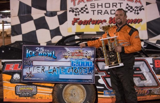 David Brannon of Elora, TN celebrates his $6,000 victory in the 50-lap Super Late Model main event on Sunday night in the 25th Annual Icebowl at Talladega Short Track in Eastaboga, AL.  Brannon's Elora Gin Special was powered by a $7,195 Chevrolet Performance CT525 All-Aluminum Racing Engine, and it was the fourth straight win at the Icebowl for the production-based engine.  (NeSmith Media Photo by Bruce Carroll)